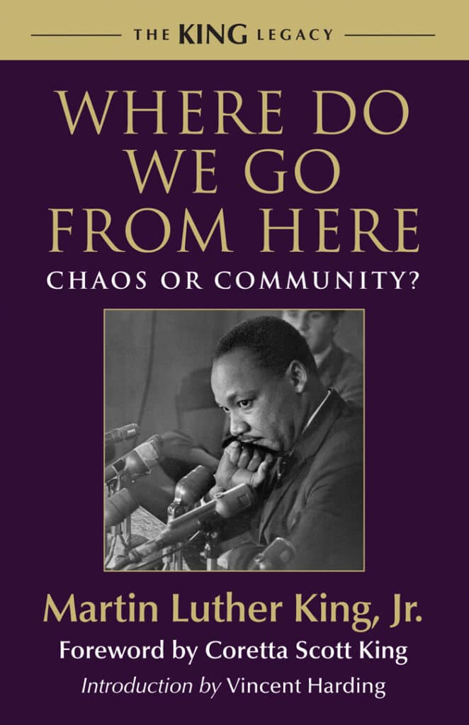 Cover of Martin Luther King's book, Where Do We Go From Here: Chaos or Community? Features a photo of King, a Black man, standing in front of microphones, head bent down, looking thoughtful